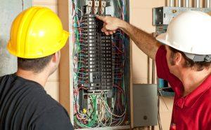 technicians checking a unit.